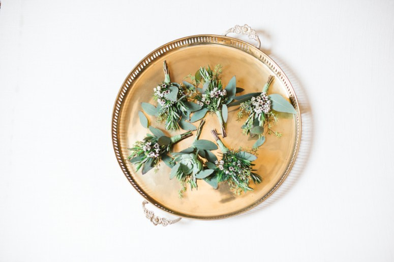 groomsmen green boutonnieres on gold tray