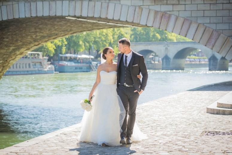 Bride and Groom Walking on Streets of Paris
