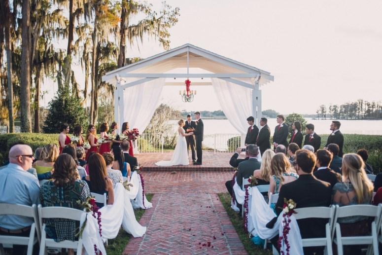 outdoor wedding under chandelier
