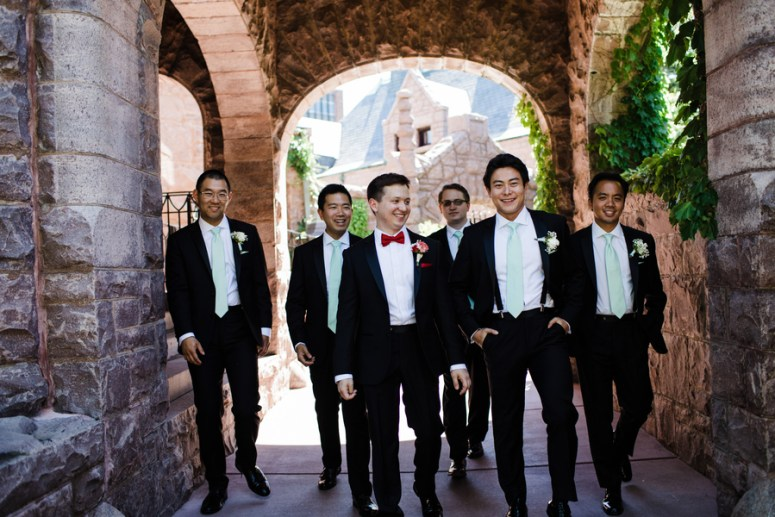 Groomsmen wearing black white and red suits