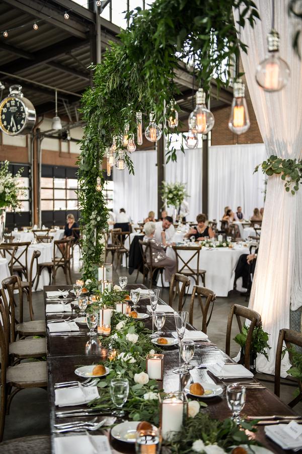 floral arch, hanging lights, unique florals for wedding, string lights for wedding, table decor for reception