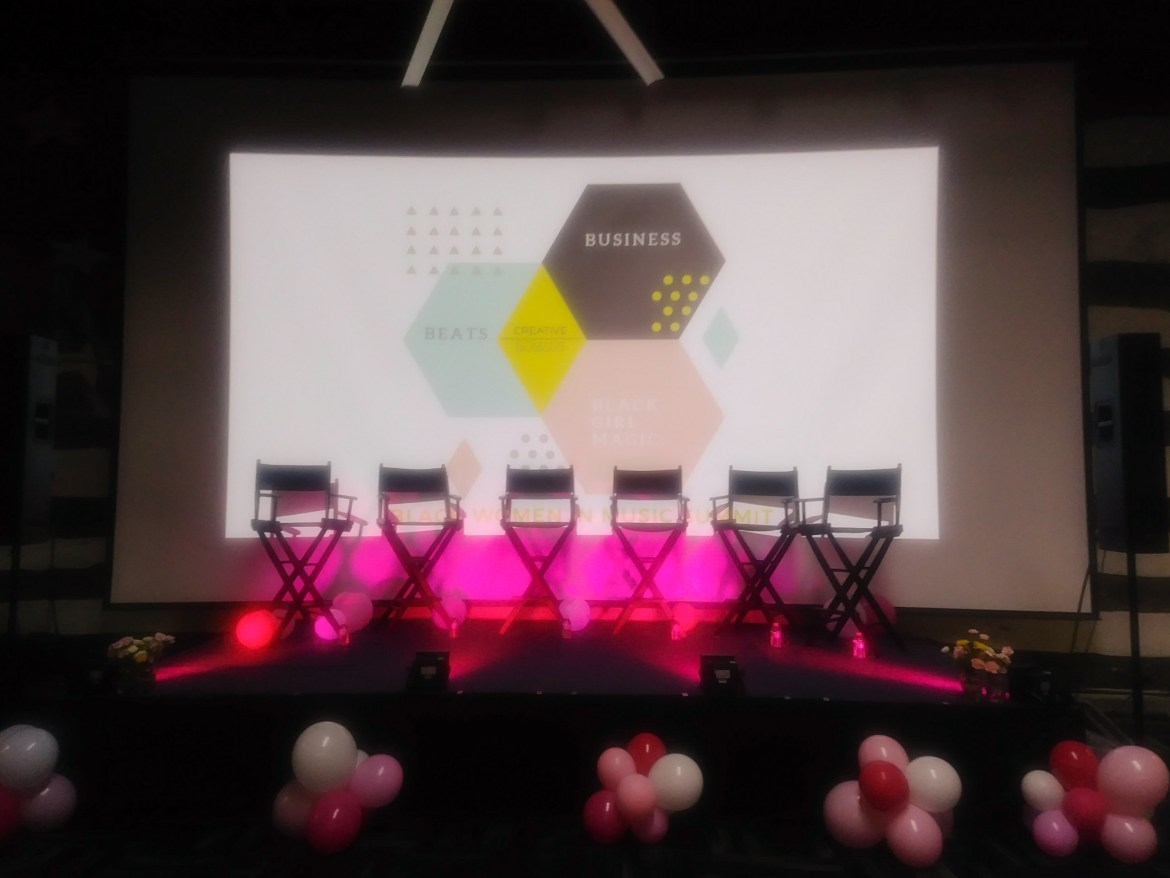 Pink stage with ballons and director chairs