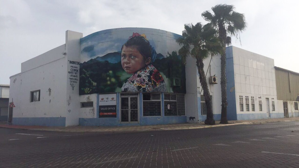 Mural of baby girl with hazel eyes in Sint Nicolas