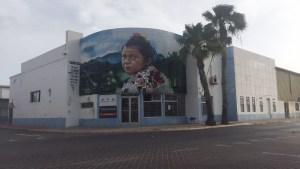 Mural of baby girl with hazel eyes in Sint Nicolas