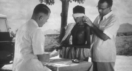 Dr. Paul Brand examines a leprosy patient