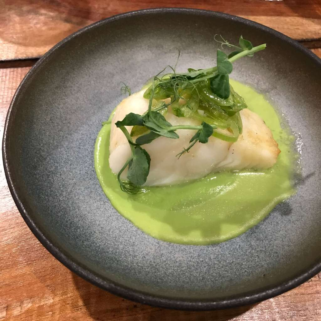 Clip Fish – peas and tarragon puree with sugar snap peas and onions
