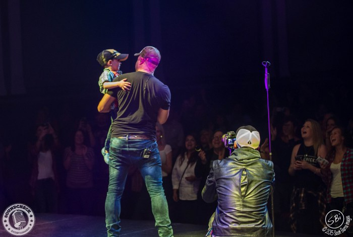 Tebey brings a little fan up on stage during his set in Oshawa at The Regent Theatre - Photo: Scott Burns Images