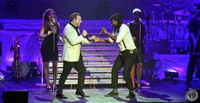 """Johnny Reid with Elage Diouf perform """"Just One Day"""" at TD Place in Ottawa March 26, 2016"""
