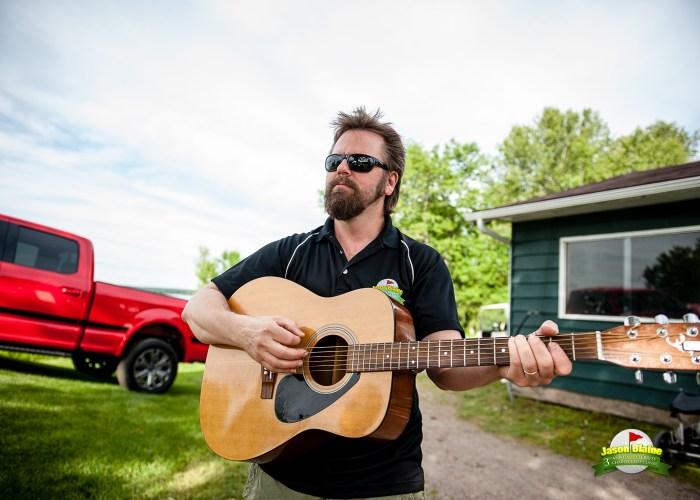 Jason McCoy Strums a tune during Jason Blaine's Celebrity Charity Golf Classic - Photo: Sean Sisk