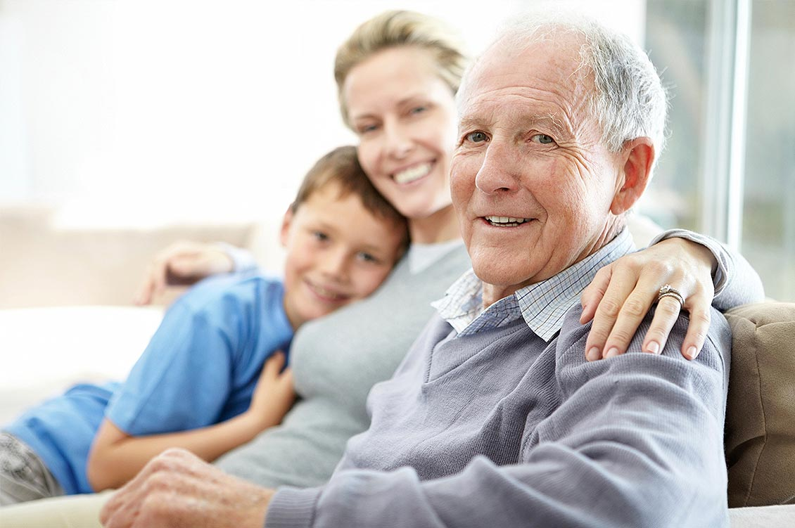 An older man sits with his daughter and grandson | Soundview Medical Supply