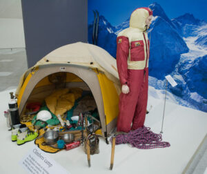 The Australians in the Himalayas: 25 years of achievement display at the National Museum of Australia. Geoff Bartram's windsuit is pictured at right, with a re-creation of an Australian climbers' camp. The suit, sleeping mats, harness, head torch and skis were actually used during the 1984 Mt Everest expedition. Photo: Jason McCarthy  (Source: nma.gov.au)