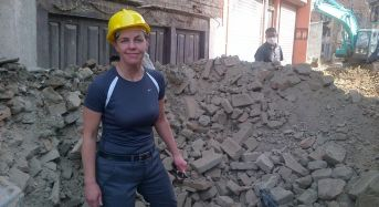 Dr Kellie Leitch, Canadian Minister for Labour, works on patients in Nepal hinterland