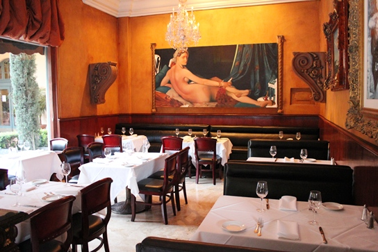 The Stunning Main Dining Room in La Traviata Faces a Courtyard.  The Main Feature is a Huge Paintaing on the Far Wall.