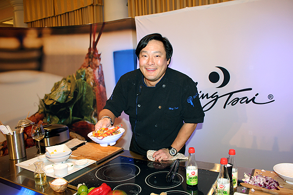 Chef Ming Tsai hands me a dish of his Sweet and Sour Pork on 2012-01-15  at Buick Food+Wine at St Regis Monarch, Dana Point 104