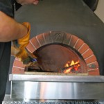 Pizzaiolo making a true Neopolitan wood fired pizza