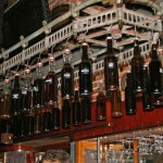 carousel of barrel aged cocktails above the bar