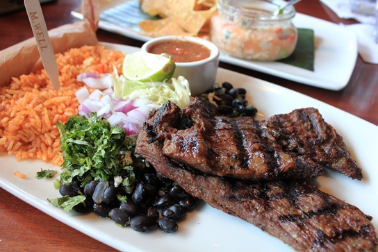 Carne Asada - Premium Angus Skirt Steak grilled to perfection and served with beans, rice, and tortillas.