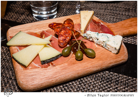 A nice assortment of cheese, olives and sausage in this charcuterie platter