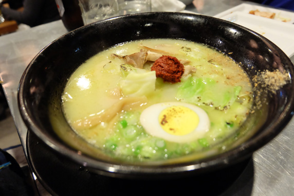 Spicy Premium Mild Ramen topped with pickled egg, chicken chasiu and their akadama ball