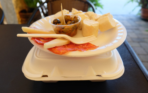 Cheese, cured meat, olives and fresh baked bread