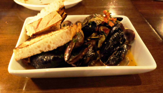 Mussels, clams,  fennel, sun dried tomato and white wine sauce loaded with butter and garlic