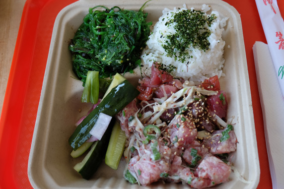Top left to bottom right: seaweed salad, rice with furikake, picked cucumbers and original and wasbi poke