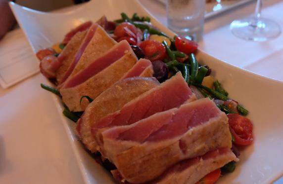 Nicoise-ish salad with ahi tuna, haricot vert, olives, egg, tomato, red onion, and lemon vinaigrette