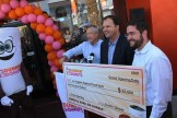 Dunkin' Donuts executives and the big check for the LA Regional Food Bank.