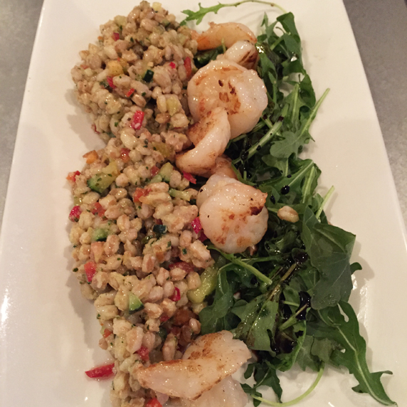 Farro with diced peppers and cucumbers; served with an arugula salad