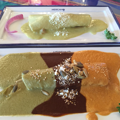 Foreground: Mole Enchilada with three sauces; Background: Enchiladas Mareñas