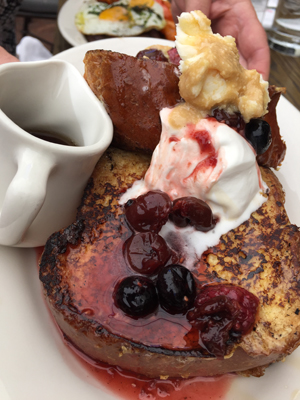 Vanilla bean french toast topped with mixed berry compote