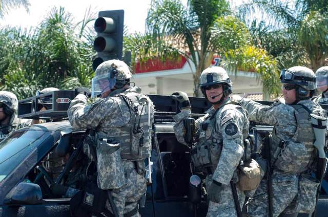 These are not American military in Iraq -- they're police officers at a protest in Anaheim, CA. Ironically, the protesters were protesting police brutality. Credit: Chase Carter, flickr