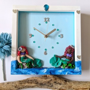 Mermaids resting Clock