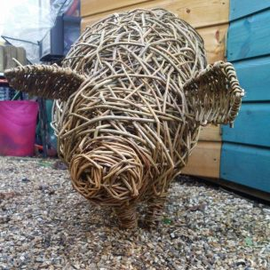 photo of willow pig sculpture from the front