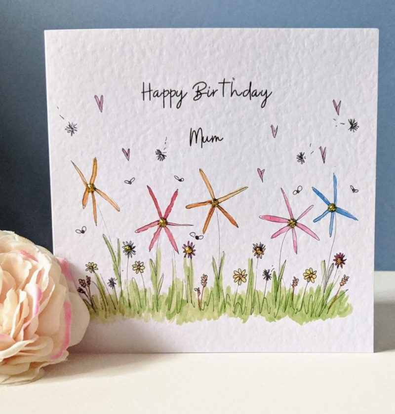 Early summer flowers greetings card in pink, yellow and blue