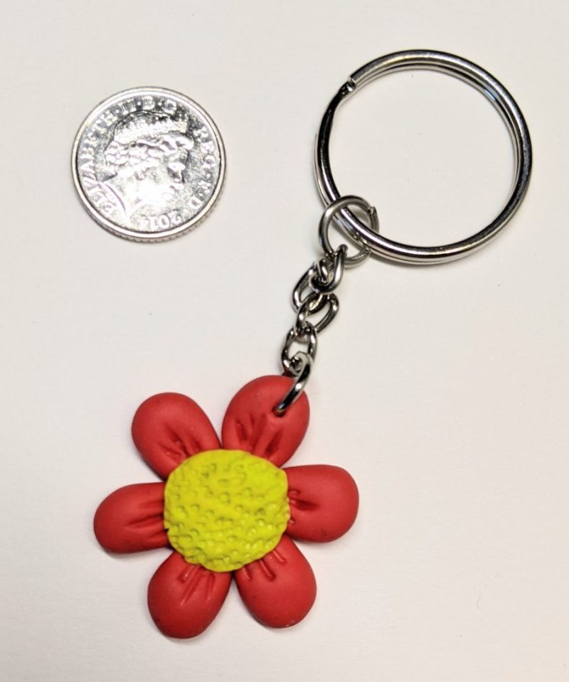 red and yellow flower keyring