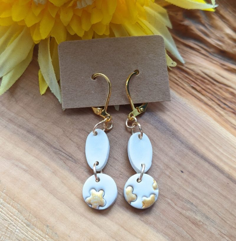 Neutral and gold small dangly earrings using gold coloured clasp hooks