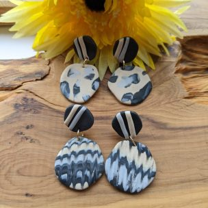 pebble shape drop earrings - black, grey and cream marble effect patterns with stiped studs