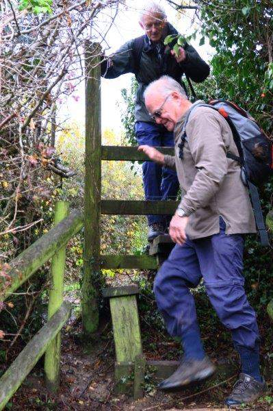 Over a dangerous stile - Mike has reported it to Glos CC and Bob