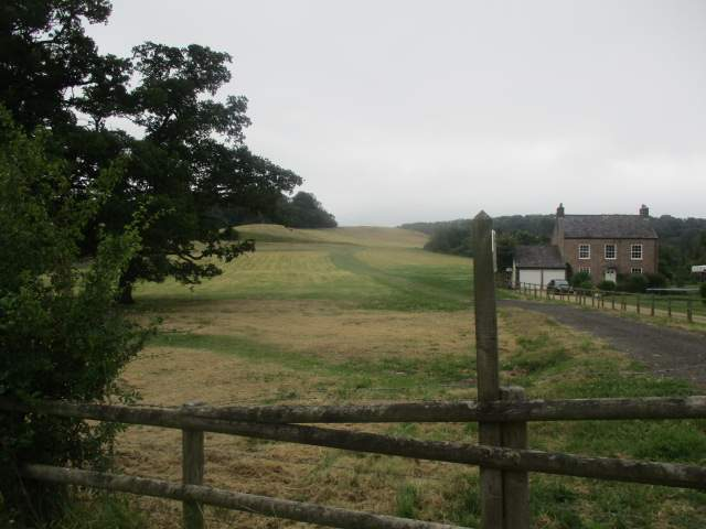 We continue along the road past fields and houses