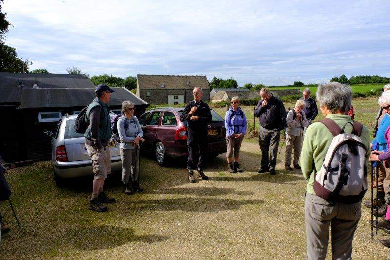 Brimpsfield village hall. Colin looks bemused at the crowd of 30  Ramblers on his walk