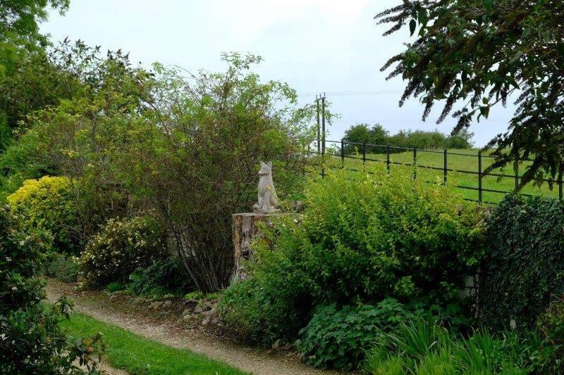 A farm entrance with a sculpture of a fox