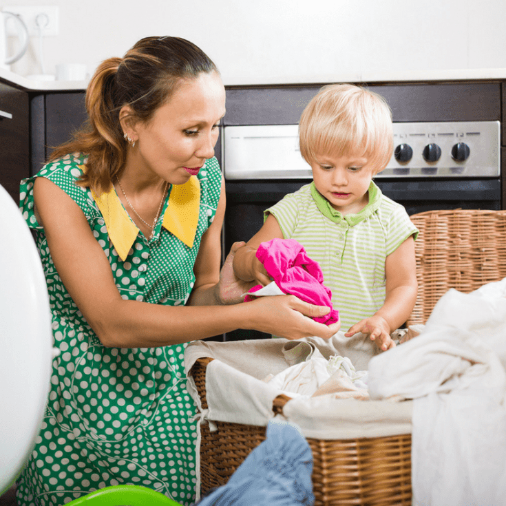 child helping with laundry