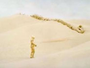"Figure 2: The bones in the background of this shot from the documentary ""A New Hope"" are a Krayt Dragon skeleton."