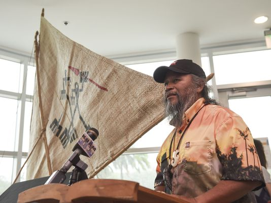 "Ignacio R. ""Nash"" Camacho, a Traditions About Seafaring Islands member, and codesigner of the Chamoru Sakman outrigger replica canoe ""Tasi,"" talks about his creation during a ceremony at the Guam Museum on June 29, 2017."