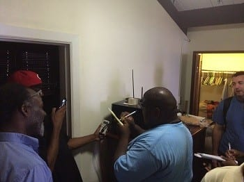 Students meter the electricity consumption of appliances during an energy audit of a Virgin Islands home.