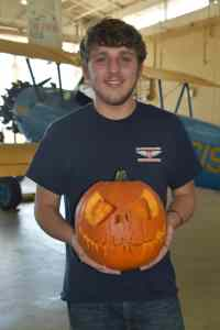 3.Drew Wohrley of the Aviation Powerplant program was the carver for the winning pumpkin in the Americus campus pumpkin carving contest. His pumpkin displayed the best carving skills of those submitted for judging.