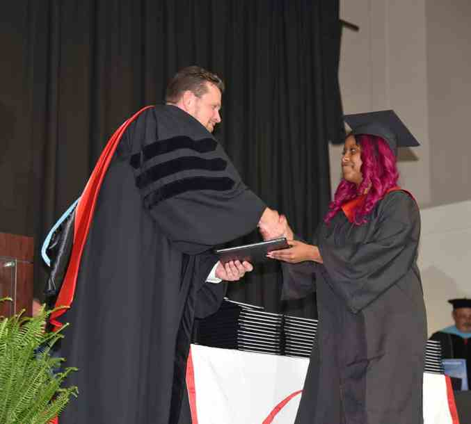 SGTC President Dr. Watford presented Shermel McCluster with her degree at South Georgia Tech's spring commencement ceremony earlier this month.