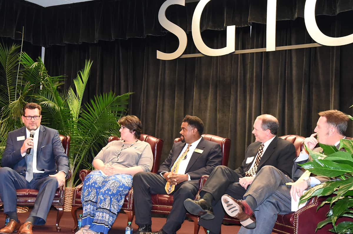 South Georgia Technical College President Dr. John Watford is shown answering a question with other panelist looking on (l to r) Dr. Elizabeth Kuipers, Dr. Terrence Choates, Ty Kinslow, and Dr. Neal Weaver