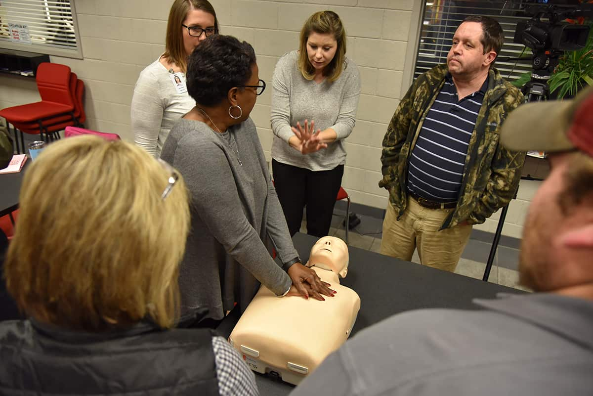 SGTC Director of Human Resources Sandy Larson offers some technique to Cynthia Carter, Director of Career Services, while she practices CPR on a dummy during a recent staff development day.